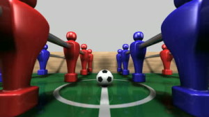 stock-footage-a-perspective-pan-through-the-middle-of-a-wooden-foosball-table-showing-a-blue-and-red-team-on-a